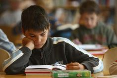 boy reading book in school - Sean Gallup/Getty Images News/Getty Images