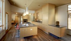 Modern home with a Modern kitchen subtly combined contrasting colors to create a warm space.