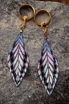 If you miss fun and feminine, dangly earrings, these are the gauges for you! Unique and Gorgeous Leather Feather Magnetic Clasp Gauged Earrings. Huge Selection of Unique plugs and Jewelry.