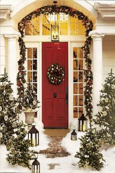 Fancy Outdoor Christmas Decoration Idea With Snowy Christmas Trees And Green Garlands With Colorful Christmas Ornaments And Wreath Decorated On Red Door And Antique Pendant Lamp - Use J/K to navigate to previous and next images Christmas Front Doors, Christmas Porch, Merry Little Christmas, Noel Christmas, Primitive Christmas, Winter Christmas, All Things Christmas, Christmas Wreaths, Christmas Entryway