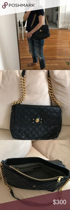 Marc Jacobs Large Quilted Leather Bag in black Marc Jacobs large quilted leather bag in black with gold hardware and chain.  Gently worn. Great condition! Marc Jacobs Bags Shoulder Bags