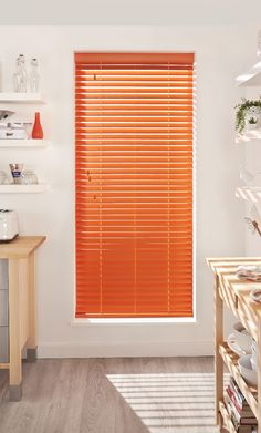Bring colour into your kitchen with bright coloured wooden blinds, pair with natural shades and neutral walls to create massive impact!