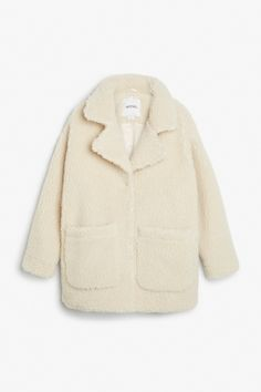 Invest early. Faux shearling coat from Monki.