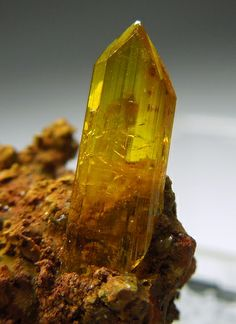 A terminated, rich yellow Legrandite crystal perched on a brown matrix.  This is by far the prettiest Legrandite I've ever seen.