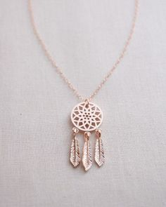 Dreamcatcher Necklace by Olive Yew. Let this small rose gold dreamcatcher charm keep all the bad dreams away.