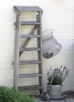 ladder, chicken waterer turned planter