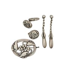 "Lot 16 - EARLY STERLING JEWELRY BY GEORG JENSEN, DENMARK - Estimate: $400 - $600 - Comprising a pair of rare pendant earrings #20, 1925-1935 A pair of vegetal cufflinks with hinged foliate back #32, and vegetal brooch #101, both 1933-1944. Drop 1 1/4"", 5/8"" dia, 1 3/4"" x 1 3/8"". 30.2 gs."