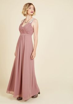<p>Pairing your magnetic personality with this mauve maxi dress, your being is a culmination of charm! Elegantly V'd at the neckline and back, boasting ruching at the bodice, and flaunting silver beads forming exquisite leaves at the shoulders, this marvelous ModCloth exclusive is nothing short of enticing.</p>