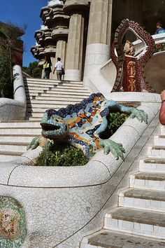 "Gaudí's multicolored mosaic salamander, popularly known as ""el drac"" (the dragon), at the main entrance, as restored after the vandalism of February 2007. Barcelona"