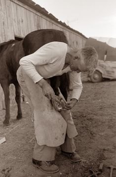 1940 - Blacksmith shoeing a horse - San Angelo, Texas.