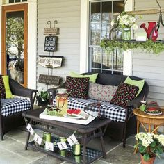 "Create a recurring theme throughout your porch seating area by picking a summer icon and working it into your decor. Here, cheery cherry-covered pillows look perfect on the black-and-white checked cushions and infuse the area with their sweet style. (For more tips, read ""Just Relax"" in our July 2014 issue.)"