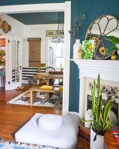 Eclectic Home Tour - Home Ec - Love this old home with blue walls and eclectic decor - Living Room Decor Eclectic, Eclectic Gallery Wall, Painted Interior Doors, Green Cabinets, Blue Walls, Home Decor Styles, Vintage Decor, House Tours, Interior Design