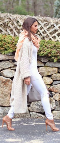 Camila Coelho is wearing white jeans from J. Brand, maxi cardigan from Zara and the shoes from Sam Edelman