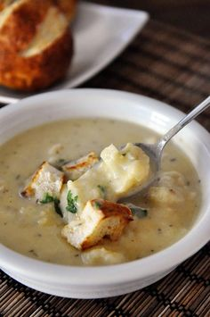 Roasted Cauliflower White Cheddar Soup - it's roasted cauliflower and fragrant garlic, savory thyme and sharp white cheddar, then you top it with croutons made from pretzel rolls.