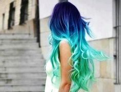 Long blue and green hair with curls I call that colorful mermaid hair