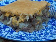 Ground beef, onions, cabbage, cheese, cream of mushroom soup, crescent rolls!  YUM!