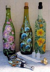 Wine bottles, handpainted with a baked on acrylic finish. Assorted tops so they may be used as wine decanters, for oil lamps, cooking or dipping oil, dish detergent or bath oil.