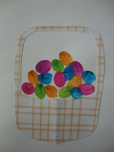 Thumb print eggs in a basket You will be making this! We can do it on Easter dinner and have all the guests put their prints in the basket! Make one every year! Write a few words about the day on the back....make a book out of them. Sounds like a great remembrance!
