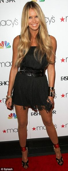 Great shoes and accessories on Elle Macpherson nice black dress.