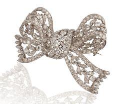 Platinum and diamond bow brooch, stamped Boucheron #estatejewelry #diamondpin #diamondbrooch