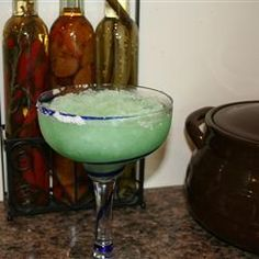 Easy Frozen Margaritas. We just made this with silver taquila - skipped the cointreau and poured a bit of club soda in the glass before pouring the margarita in. YUM.