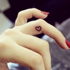 This Mini Heart tattoo is simple and perfect.