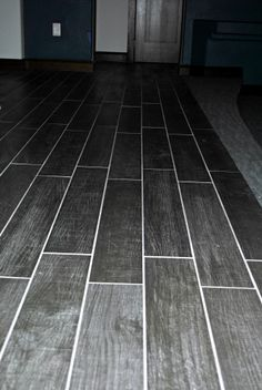 wood look in a cerami tile that features grays and grain
