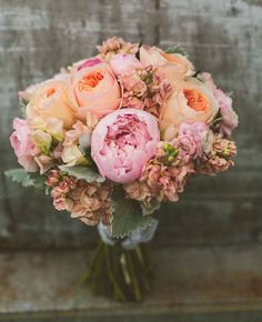pretty peach and pink peony, garden rose, hydrangea, sweet pea and stock bouquet by Studio Emme