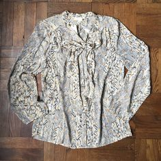 "Anthropologie Blouse Meadow Rue for Anthropologie. Gathered back and front button detail. Bracelet sleeve. Graphic pattern with gold fleck spotting. Polyester. Necktie! 26"" L and 19.5"" underarm to underarm. Anthropologie Tops Blouses"