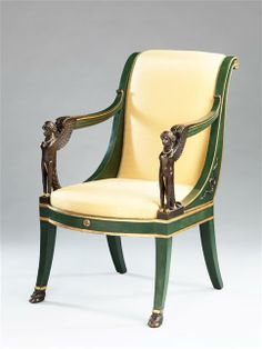 EMPIRE PARCEL GILT FAUTEUIL / France, c. 1810 / with arms fashioned as sphinxes, scroll backs with entwined serpents, hooves on front legs