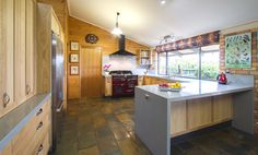 An eclectic and organic kitchen with all the modern conveniences of today. www.thekitchendesigncentre.com.au @thekitchen_designcentre