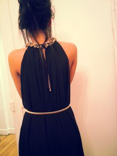 Black dress with necklace and belt