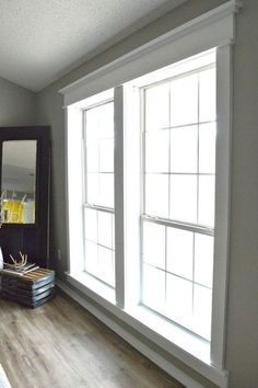 DIY Craftsman Window Trim is part of Living Room Windows And Doors - door trim that makes my heart melt I think it's the perfect way to add character to any space, but especially… Craftsman Window Trim, Interior Window Trim, Craftsman Houses, Craftsman Interior, Interior Shutters, Craftsman Style, Farmhouse Trim, Farmhouse Windows, Farmhouse Plans