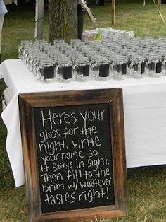 Mason Jars w/ Chalkboard paint. Great as a wedding favor!