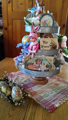 Learn how to make Easy Dollar Store Easter Decorations for the Home - Tiered Trays! These are the perfect Spring decorations you can make on a budget to brighten up you home! Homemade Halloween Decorations, Christmas Decorations, Holiday Decorating, Vintage Easter, Vintage Christmas, Galvanized Tiered Tray, Easter Crafts, Easter Decor, Hoppy Easter