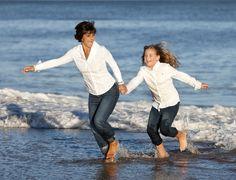 Mother and daughter running on the beach   Deborah Kalas Portrait Photography