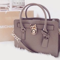 I love Michael Kors tote.They're super stylish $68 OMG!!http://ingeniousbag.coalnet.ru/