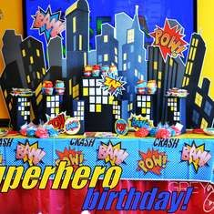 cute spider-man party with gifts bags and centerpieces
