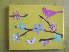 Painted canvas decoupaged with cut out paper bird and flowers.