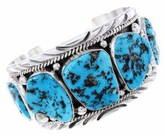 """Sleeping Beauty Turquoise Native American Silver Bracelet Cuff MW64996 SilverTribe. $699.99. Sleeping Beauty Turquoise Native American Silver Bracelet Cuff MW64996. Southwestern Jewelry. MATERIALS: Sterling silver and Sleeping Beauty Turquoise.. MEASUREMENTS: The inner bracelet circumference measures approximately 6-5/8"""", plus a 1-3/8"""" opening, and 1-1/2"""" at widest point. The bracelet weighs 109 grams."""