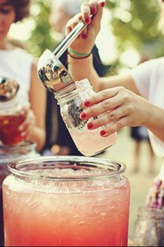 Self serve strawberry lemonade in mason jars, oh yes!
