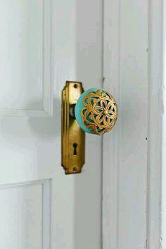 Golden turquoise antique door knob and lock.