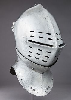 Tournament Helm Date: ca. 1490 Culture: possibly British or Flemish Medium: Steel, leather, textile, copper alloy Dimensions: H. 15 3/4 in. (40 cm); W. 8 1/2 in. (21.6 cm); D. 13 1/4 in. (33.7 cm); Wt. 12 lb. 12 oz. (5783 g)