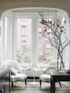 Branches Inside the Home- a great way to emphasize verticality and tall ceilings - love this space