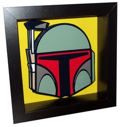 This Boba Fett Star Wars 3D pop art is a three dimensional rendering of one of the greatest bounty hunters throughout the galaxy. Boba Fett will stop at nothing to get what he's after. Now Boba Fett is available in this framed 3-D pop artwork. Boba's helmet is rendered in 3-D, which contrasts nicely against the yellow background.     Boba Fett is the perfect companion piece to my other Star Wars 3-D pop artwork, which includes intergalactic best friends C-3PO and R2-D2. Each pieces is sold…