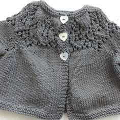 Knitting Pattern for a cute baby and toddler cardigan with lace on the yoke.Sizes to Fit 0-3 6-12 18-24 30-36 monthsChest: 40(16) 45.5(18) 50.75(20) 55.75(22) cm/in Actual Chest: 49(19¼) 57(22½) 60(23½) 66.5(26) cm/in Back Length: 17.25(7) 19.75(7¾) 24.5(9½) 29(11½) cm/in Sleeve length: 10(4) 12(4¾) 14(5½) 18(7) cm/inMaterials 2[2:3:4] x 50g balls Debbie Bliss Baby Cashmerino (125 m per ball) 3 small buttons 1 x 60 cm circular needle size 3.25 mm (US3) 1 set double pointed...