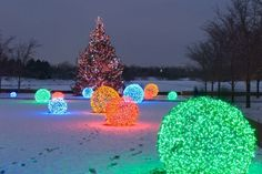 Looking for unique outdoor Christmas light ideas? Make your own homemade Lighted Christmas Balls! They are actually easy to make with just a few supplies.