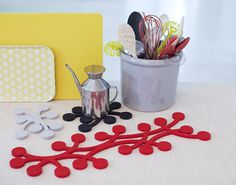 Design: Tuttu Sillanpää Marja ('berry') trivets were introduced in 2009 and became an instant success. A cherry bunch was the starting point of this playful design.