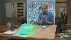Nancy demonstrates how to make no-hassle ½-square triangles using the speediest, most accurate and no-math ways. Among the ½-square triangle quilt blocks featured in this program are the Box Quilt, Shadow Play, Godey Design, Square in a Square, May Basket and Nancy's Spool blocks. Nancy uses these blocks in a sampler quilt featured in the series. Watch Part 2.