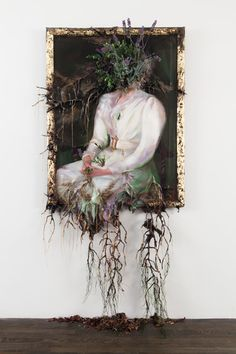 """Valerie Hegarty - Woman in White with Flowers. Canvas, stretcher, acrylic paint, paper, glue, foil, foam, wire, artificial foliage and flowers, sand, thread 84""""x44""""x15"""" (2012)"""